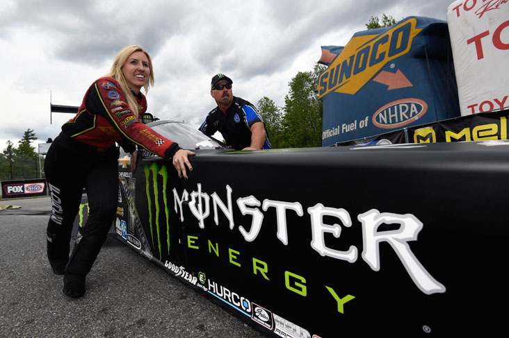 Courtney Force pushing her sister's car