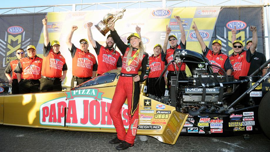 Leah Pritchett with her team in the Winternationals winner's circle