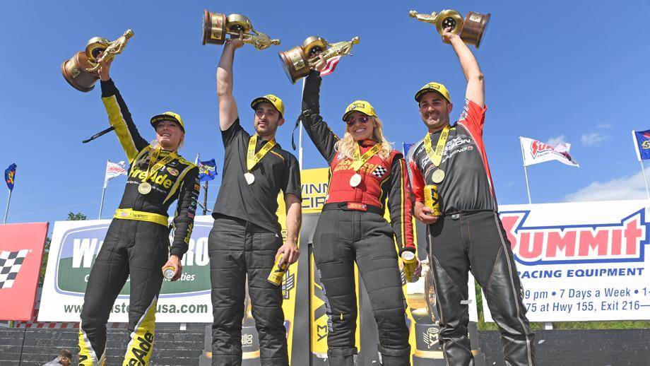 The winners of the NHRA Southern Nationals Powered by Mello Yello hold their Wallys