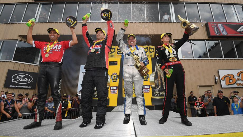 The event winners, from left, Hector Arana Jr., Greg Anderson, John Force, and Leah Pritchett.