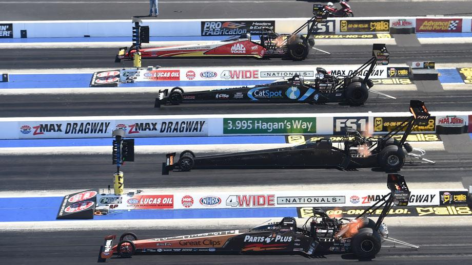 ... to the four-wide format with an action-packed and variety-spiced weekend when the NGK Spark Plugs NHRA Four-Wide Nationals revs up at zMAX Dragway in ...