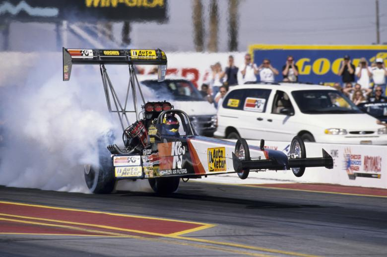 Second-generation Aussie nitro pilot Andrew Cowin showed the power and fury of a Top Fuel dragster by simultaneously wheelstanding and smoking the rear tires on this launch at the 1999 Phoenix event.