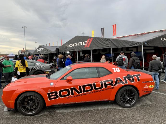 The Dodge and Mopar display at the NHRA Midwest Nationals features Bondurant Driving School Hellcat Challengers