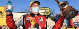 Doug Kalitta pilots his Top Fuel dragster past Steve Torrence in final