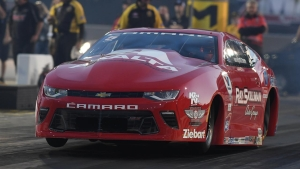 Drew Skillman races his red Camaro to the No. 1 qualifier to get a green hat in Charlotte