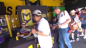 Racers pass out autographs to fans at the Mello Yello Powerhouse in Las Vegas