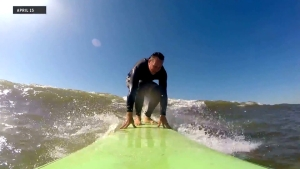 Funny Car driver Jeff Diehl surfs the Gulf of Mexico