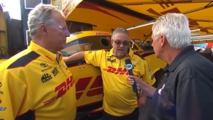 Lee Beard discusses qualifying strategy with DHL Funny Car crew chiefs Jim Oberhofer and Todd Smith