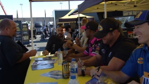 Fans line up for autographs at the Mello Yello Power House